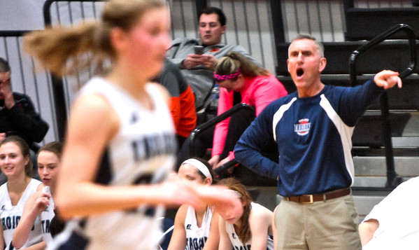 Michelle LaVigne/ For Shaw Media Cary-Grove's coach Rod Saffert gives instruction to the team during the opener of Class 4A McHenry Regional in McHenry on February 15, 2016.