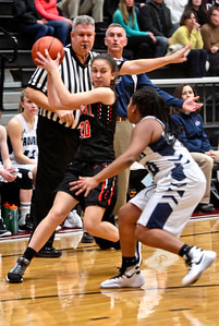 Michelle LaVigne/ For Shaw Media Crystal Lake Central's Alexandra Scarfe (20) attempts to pass around Cary-Grove's Vanessa Morris (10)during the opener of Class 4A McHenry Regional in McHenry on February 15, 2016.