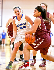 Michelle LaVigne/ For Shaw Media Woodstock's Autumn Overly and Marengo's Trinity Chanthalansy during Thursday's game at Woodstock High School on February 9th, 2017.