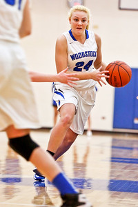 Michelle LaVigne/ For Shaw Media Woodstock's Julia Vocburgh drives the ball down the court during Thursday's game at Woodstock High School on February 9th, 2017.
