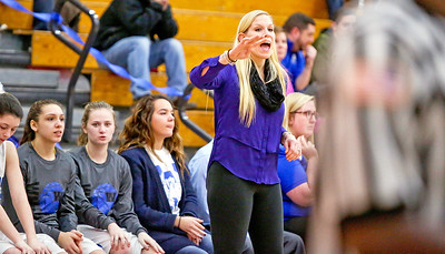 Michelle LaVigne/ For Shaw Media Woodstock's coat Jen Nichols-Holgle talks to her team during their game against Marengo at Woodstock High School on February 9th, 2017.