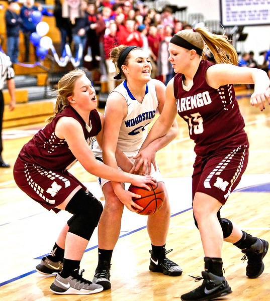 Michelle LaVigne/ For Shaw Media Marengo's Hannah Ritter, Woodstock's Gabriella Scolio and Marengo's Amy Rohe during Thursday's game at Woodstock High School on February 9th, 2017.