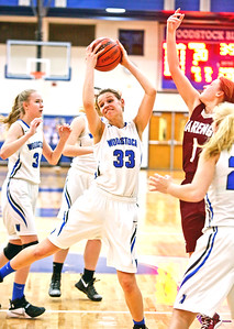 Michelle LaVigne/ For Shaw Media Woodstock's Diana Spokas regains control of the ball during Thursday's game at Woodstock High School on February 9th, 2017.
