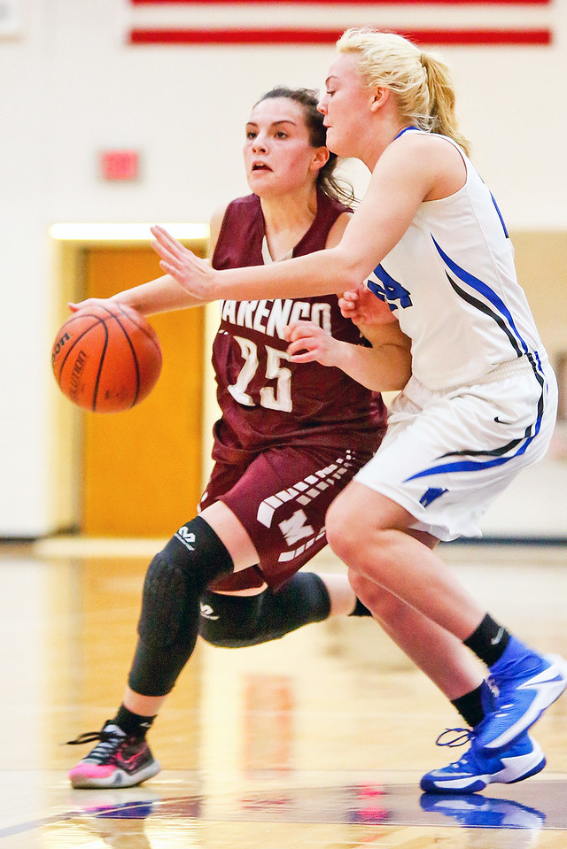 Michelle LaVigne/ For Shaw Media Woodstock's Julia Vosburgh guards Marengo's Marissa Knobloch during Thursday's game at Woodstock High School on February 9th, 2017.