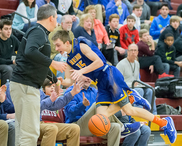 Johnsburg's Zach Toussaint goes in to the stands after an attempted save Friday Feb. 2, 2017 at Richmond-Burton High School in Richmond. Richmond went on to win 66-57 with Toussaint finishing with 23 points. KKoontz – for Shaw Media