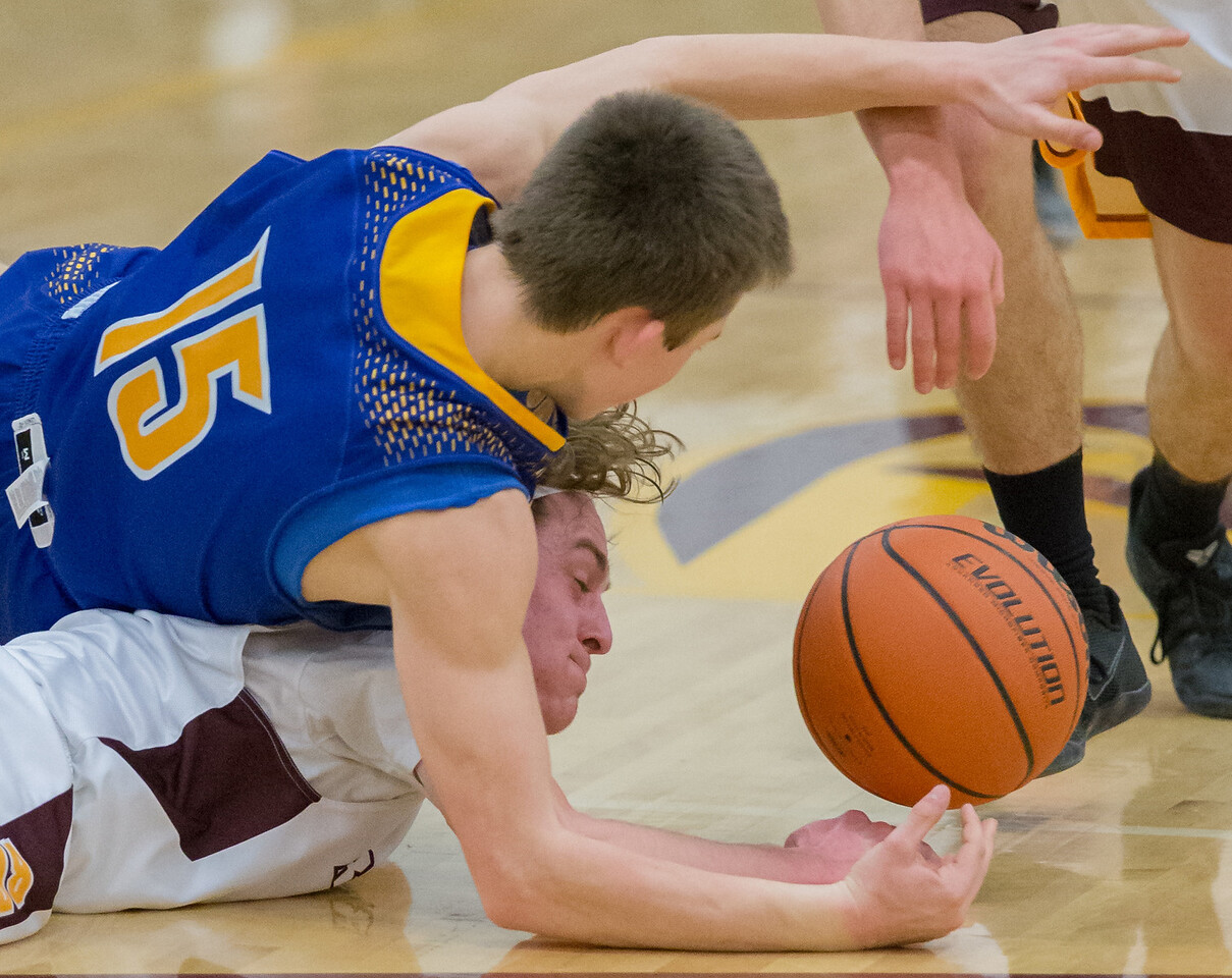 Richmond-Burton's Blaine Bayer (bottom) and Johnsburg's Zach Toussaint (15) dive for the ball Friday Feb. 2, 2017 at Richmond-Burton High School in Richmond. Richmond went on to win 66-57, with Bayer finishing with 24 points. KKoontz – for Shaw Media