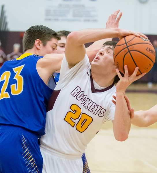Richmond-Burton's Jakob Kaufman (20) is fouled by Johnsburg's Brody Frazier (23) Friday Feb. 2, 2017 at Richmond-Burton High School in Richmond. Richmond went on to win 66-57. KKoontz – for Shaw Media