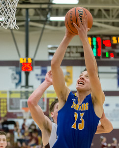 Johnsburg's Brody Frazier drives for the basket Friday Feb. 2, 2017 at Richmond-Burton High School in Richmond. Richmond went on to win 66-57. KKoontz – for Shaw Media