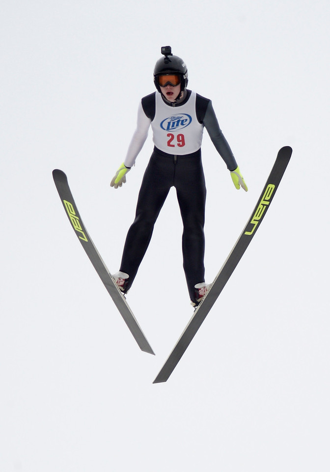 Norge ski jumper Hunter Gibson flies off the 70 meter jump at Norge Ski Club on Saturday, Feb. 11, 2017, during a trail jump for the U16 division.