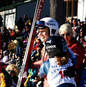 Kayla Wolf for Shaw Media– Cara Larson, left, and Anna Hoffman, front, hug Sunday, Feb. 12, 2017, after competing in the U20 women's completion at Norge Ski Club's 112th International Winter Tournament in Fox River Grove. Originally there were six competitors signed up for the U20 women's competition, but only two jumpers competed.