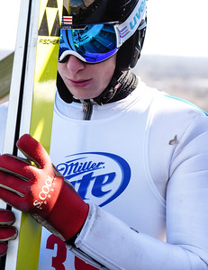Kayla Wolf for Shaw Media– Class A jumper Brian Wallace of St. Paul, Minneapolis takes a breathe Sunday, Feb. 12, 2017, before completing a trail jump off the 70 meter jump at Norge Ski Club. The official wind speed was recorded as 26 miles per hour for the competition.