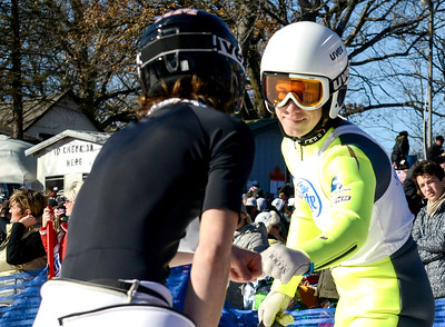 Kayla Wolf for Shaw Media– Norge Ski Club's  Patrick Gasienica (cq), right, is congratulated by Nick Mattoon on Sunday, Feb. 12, 2017 at Norge Ski Club in Fox River Grove. Gasienica placed third and Mattoon placed second in the Class A division.