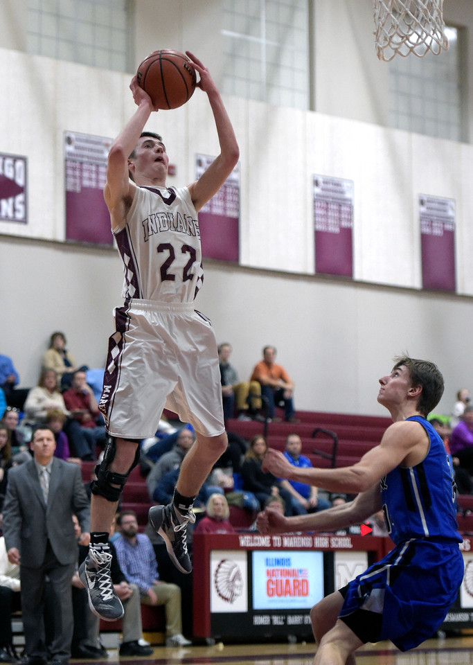 Kayla Wolf for Shaw Media– Marengo senior Carter Olson shoots the ball Tuesday, Feb. 14, 2017. Burlington Central won 63-43.