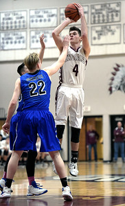 Kayla Wolf for Shaw Media– Marengo junior Alexander Schirmer (cq) shoots the ball as Burlington Central senior Joseph Ratzek (cq) goes to block the shot Tuesday, Feb. 14, 2017 at Marengo High School. Burlington Central won 63-43.