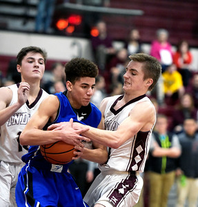 Kayla Wolf for Shaw Media– Marengo senior Michael Volkening (cq) fights for the ball Tuesday, Feb. 14, 2017, with Burlington Central sophomore Patrick Mayfield at Marengo . Burlington Central won 63-43.