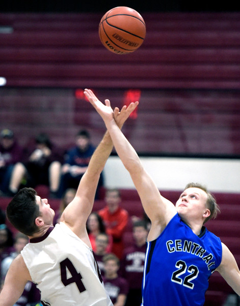 Kayla Wolf for Shaw Media– Marengo junior Alexander Schirmer (cq) and Burlington Central senior Joseph Ratzek (cq)go up for the jump ball Tuesday, Feb. 14, 2017 at Marengo Burlington Central gained position off of the jump ball.