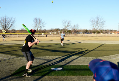 Kayla Wolf for Shaw Media– Bob Myers, left, waits for a pitch Saturday, Feb. 18, 2017, thrown by David Novy at Lippold Park in Crystal Lake. The group was playing a pickup game of softball.