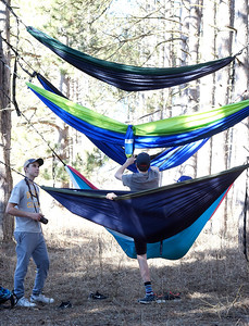 Kayla Wolf for Shaw Media–Mateo Herrera, left, watches as Max Herrera climbs into a hammock Saturday, Feb. 18, 2017, at Veterans Acres in Crystal Lake.