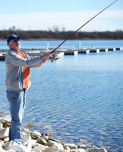 Kayla Wolf for Shaw Media– Fisherman Bill Genader (cq) casts a line Saturday, Feb. 18, 2017, at Three Creeks in Crystal Lake. Genader hadn't caught a fish, although he said a few fisherman earlier in the day caught a very tiny fish.