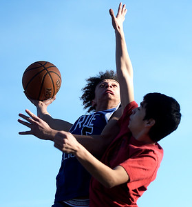 Kayla Wolf for Shaw Media–Tre Blalark (cq) goes up for a basket during a pickup game of basketball Saturday, Feb. 18, 2017, at Veteran's Acres in Crystal Lake.