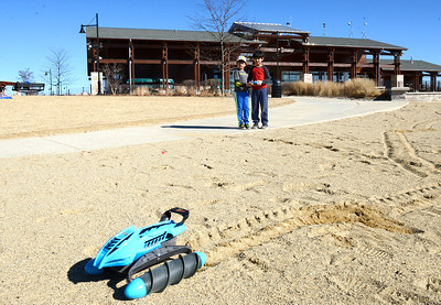 Kayla Wolf for Shaw Media– Ranveer Dhingra, 7, left, and Samik Khanna play with a remote control toy Saturday, Feb. 18, 2017 at Three Oaks Recreation Area in Crystal Lake.  The high of the day reached 64 degrees according to the National Weather Service.
