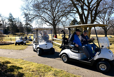 Kayla Wolf for Shaw Media– Golf carts line up Saturday, Feb. 18, 2017, at the first tee box at Cary Country Club. The golf course sent an email out to let the community know it would be open this weekend because of the unseasonably warm weather.