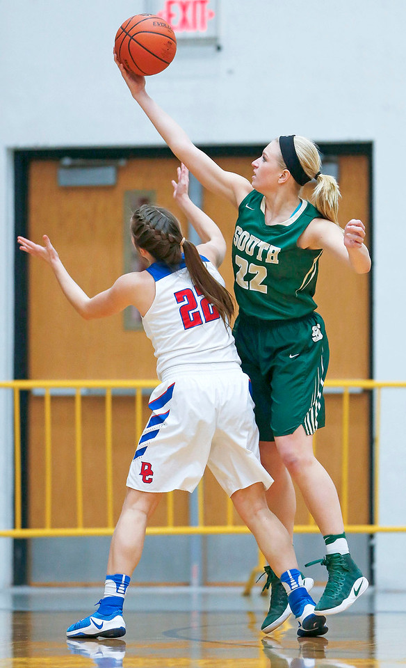 Annika Sevcik (22) from Crystal Lake South grabs a balloter the top of Anna Kieltyka (22) from Dundee-Crown during the first quarter of their Class 4A regional final game at McHenry West on Thursday, February 16, 2017 in McHenry. The Chargers defeated the Gators 45-22.   John Konstantaras photo for the Northwest Herald