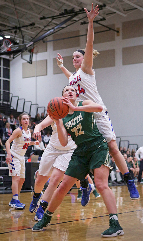 Annika Sevcik (22) from Crystal Lake South is fouled by Paige Gieseke (24) from Dundee-Crown during the second quarter of their Class 4A regional final game at McHenry West on Thursday, February 16, 2017 in McHenry. The Chargers defeated the Gators 45-22.  John Konstantaras photo for the Northwest Herald