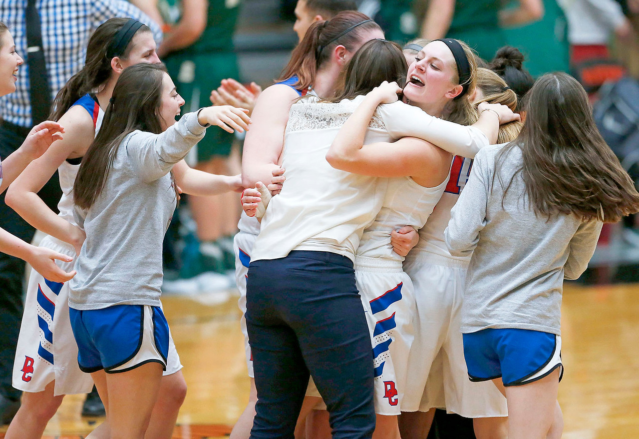 Dundee-Crown head coach Sarah Miller hugs Paige Gieseke (24) after beating Crystal Lake South in their Class 4A regional final game at McHenry West on Thursday, February 16, 2017 in McHenry. The Chargers defeated the Gators 45-22.<br /> <br /> John Konstantaras photo for the Northwest Herald