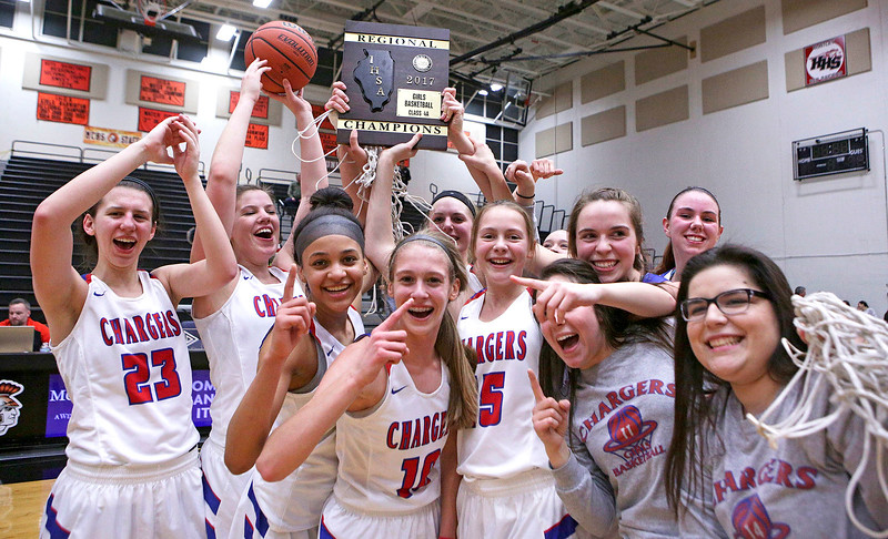 Dundee-Crown players celebrate with their Class 4A regional championship plaque after beating Crystal Lake South at McHenry West on Thursday, February 16, 2017 in McHenry. The Chargers defeated the Gators 45-22.  John Konstantaras photo for the Northwest Herald