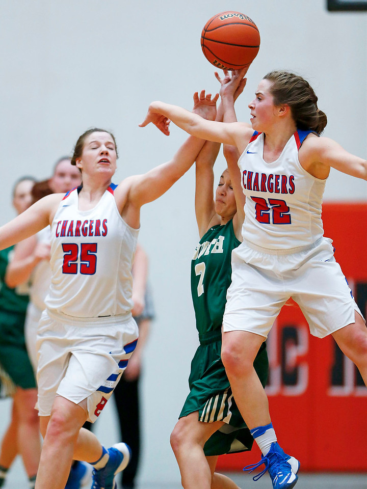Allison Michalski (25) and Anna Kieltyka (22) from Dundee-Crown reach for a ball over Annalisa Toniolo (2) from Crystal Lake South during the second quarter of their Class 4A regional final game at McHenry West on Thursday, February 16, 2017 in McHenry. The Chargers defeated the Gators 45-22.  John Konstantaras photo for the Northwest Herald
