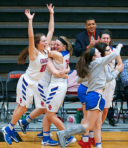 Anna Kieltyka (22), Allison Michalski (center) and Paige Gieseke (24) from Dundee-Crown celebrates after defeating Crystal Lake South during their Class 4A regional final game at McHenry West on Thursday, February 16, 2017 in McHenry. The Chargers defeated the Gators 45-22.  John Konstantaras photo for the Northwest Herald
