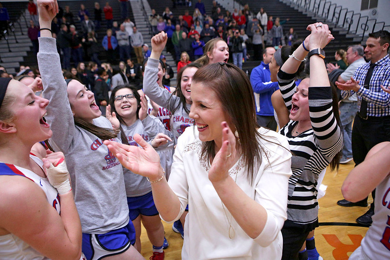 Dundee-Crown head coach Sarah Miller celebrates with her team after beating Crystal Lake South in their Class 4A regional final game at McHenry West on Thursday, February 16, 2017 in McHenry. The Chargers defeated the Gators 45-22.  John Konstantaras photo for the Northwest Herald