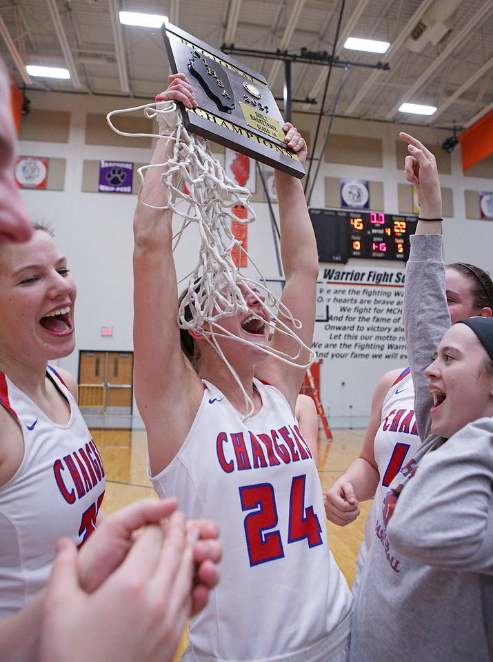 Paige Gieseke (24) from Dundee-Crown holds their regional championship plaque over her hear after beating Crystal Lake South in their Class 4A regional final game at McHenry West on Thursday, February 16, 2017 in McHenry. The Chargers defeated the Gators 45-22.  John Konstantaras photo for the Northwest Herald
