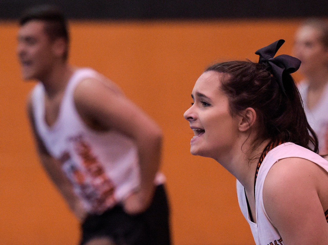 Jessica Rudolph cheers on teammate Amanda Dumovich (cq), not pictured, as her teammate practices a pass across the floor on Wednesday, Feb. 1, 2017 as the team prepares for the state competition. The Crystal Lake Central High School cheerleading team won the ___ sectional and will leave for the state competition Thursday.