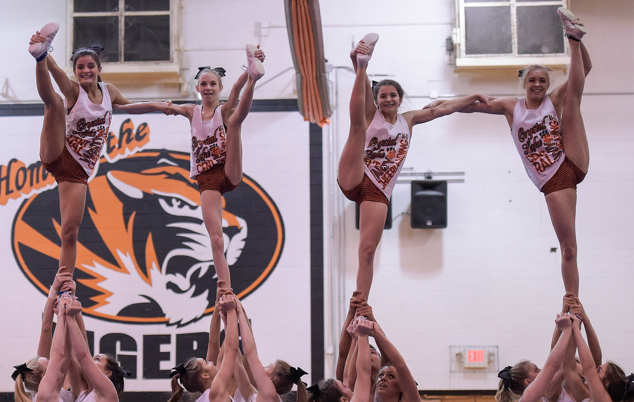 From left, Jessica Murphy, Sara Nuttall(cq), Halle Rogers (cq) and Abby Ottewis (cq) hit the last skill of the routine the Crystal Lake Central High School cheerleading team with preform for the state competition during practice on Wednesday, Feb. 1, 2017. The team has the highest score going into the state competition.