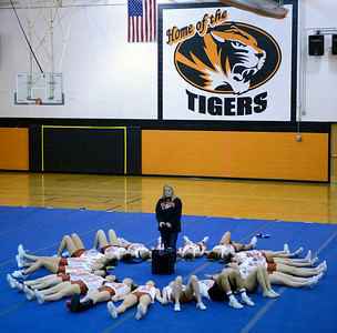 Crystal Lake Central High School cheerleading Head Coach Elizabeth Brauneis leads the team through visualizing their routine, a ritual the team does before preforming. Brauneis has been coaching the cheerleading team for seven years.