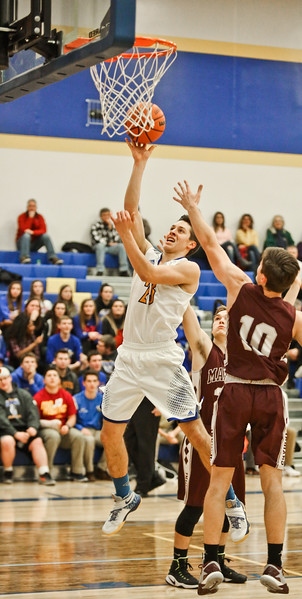 Michelle LaVigne/ For Shaw Media Johnsburg's Brody Frazier heads up for a basket during Marengo at Johnsburg High School on February 2, 2017.