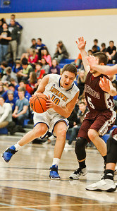 Michelle LaVigne/ For Shaw Media Johnsburg's Mason Sobieski goes up against Marengo's Blaine Borhart during Marengo at Johnsburg High School on February 2, 2017.