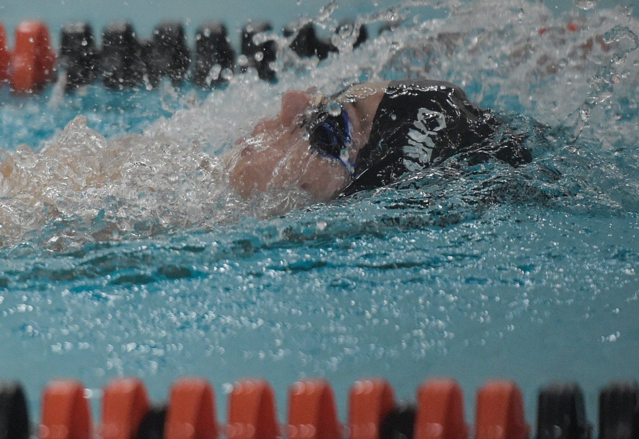 Eric Christensen swims the backstroke during a dual meet at McHenry West on Thursday, Feb. 2, 2017.