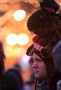 Jake Reich, of Union, stands in front of the bandstand in Woodstock, Illinois, to see Woodstock Willie emerge from a tree trunk on February 2, 2017. It was 15 degrees outside with a windchill of zero degrees according to the national weather service.
