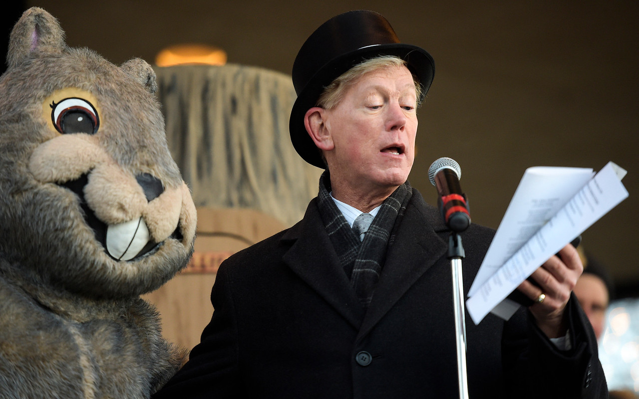 Woodstock Mayor Dr. Brian Sager sings with Woodstock Willie the mascot February 2, 2017, in Woodstock. The Groundhog Day movie was filmed in Woodstock in 1992.