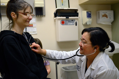 Dr. Emily Shen listens to Christina Mancuso breath during a visit to the Mercy clinic in Crytsal Lake on Thursday, February 2, 2017. Mancuso said Shen has been their family doctor for years and she has been awesome.