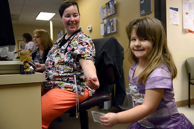 Nurse Casey Haefs (cq) hands Emma Mancuso, 4, a sticker after a visit to Mercy Clinic in Crystal Lake on Thursday, February 2, 2017.