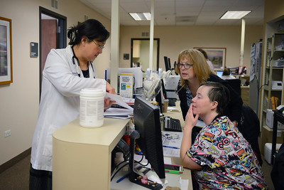Dr. Emily Shen talks to her nurses, Nurses Casey Haefs (cq) front, and and Kathryn Olson, about the day's schedule of appointments at the Mercy Clinic in Crystal Lake on February 2, 2017. Mercy Health Systems has proposed new hospital at the corner of Three Oaks Road and Route 31.