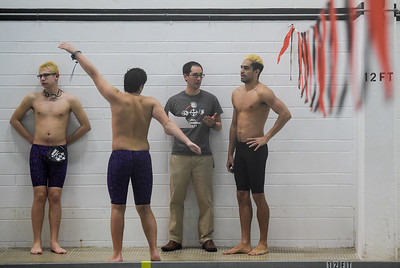 Omid Babakhani, right, talks with Cary-Grove co-op swim team Head Coach Scott Lattyak during a meet at McHenry West on Thursday, Feb. 2, 2017.