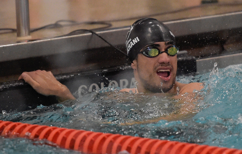Omid Babakhani of the Cary-Grove co-op swim team looks at his split time for the his leg of the 400-yard freestyle relay on Thursday, Feb. 2, 2017.