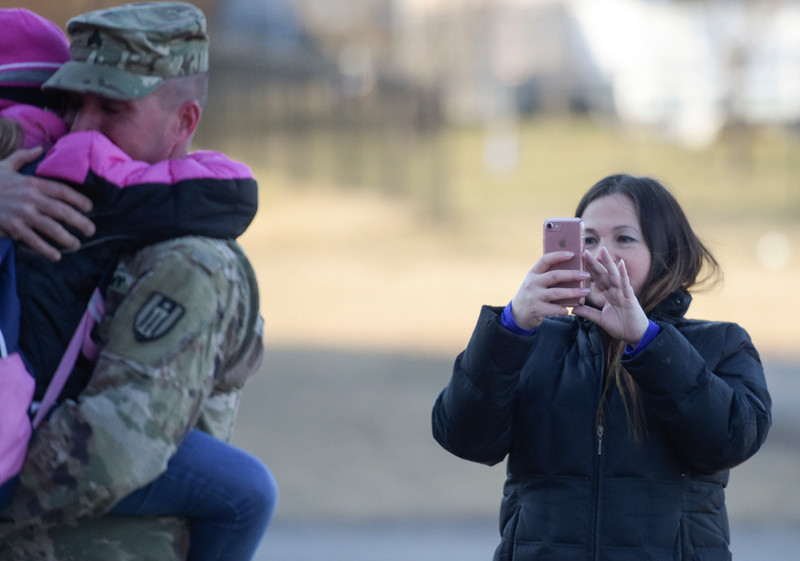 Rebecca Angeles takes a video of Srgt. Brent Lane and their daughter Elise Lane on Thursday Feb. 2, 2017.