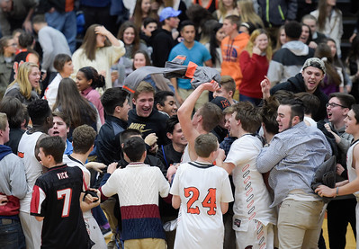McHenry students storm the court to celebrate a close win over the Prairie Ridge boys basketball team at McHenry West High School on Friday, February 3, 2017. McHenry won 53-51.
