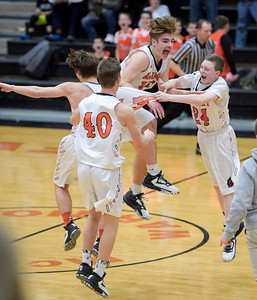 McHenry junior Patrick Breisch, center, celebrates the team's win over Prairie Ridge on their home court on Friday, February 3, 2017. McHenry won 53-51.